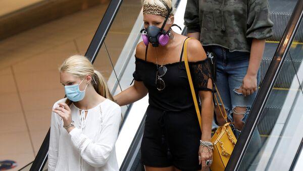 Des personnes portant des masques de protection à Ottawa - Sputnik France