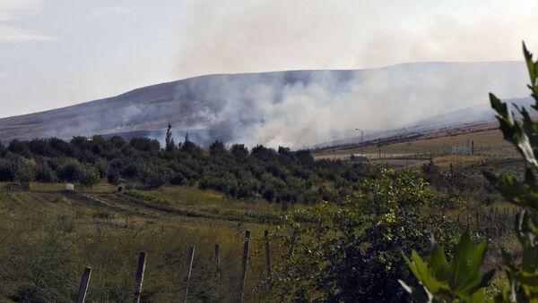 Un incendie provoqué par des tirs d'artillerie au Haut-Karabakh, 29 septembre 2020 - Sputnik France