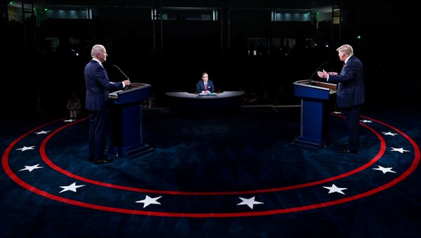 U.S. President Donald Trump and Democratic presidential nominee Joe Biden participate in the first 2020 presidential campaign debate held on the campus of the Cleveland Clinic at Case Western Reserve University in Cleveland, Ohio, U.S., September 29, 2020. - Sputnik France