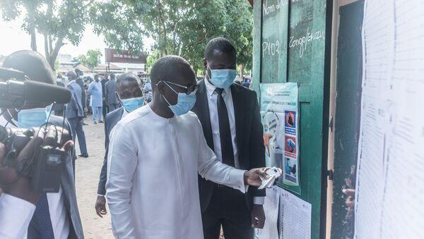 Le Président du Bénin Patrice Talon arrive à son bureau de vote pour les élections municipales béninoises - Sputnik France