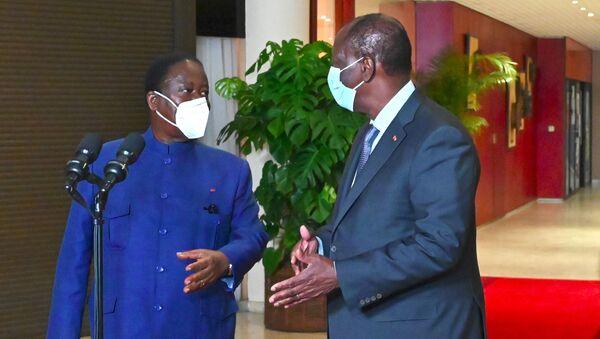 Le Président ivoirien Alassane Ouattara et le leader de l'opposition Henri Konan Bédié - Sputnik France