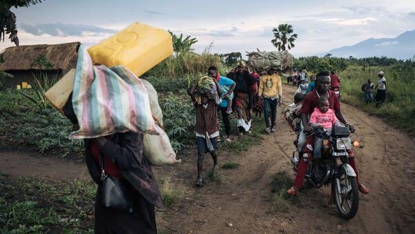 Des réfugiés fuient leur village de Halungupa, près de Béni, après l'attaque des AFD en RDC - Sputnik France