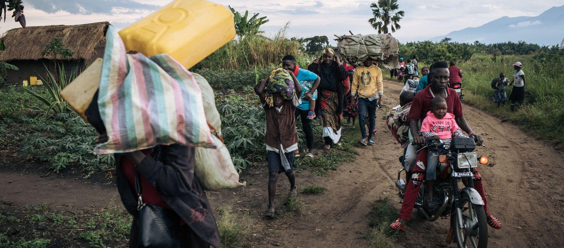 Des réfugiés fuient leur village de Halungupa, près de Béni, après l'attaque des AFD en RDC - Sputnik France, 1920, 13.11.2020