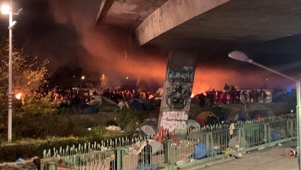 L'évacuation du camp de migrants de Saint-Denis (Seine-Saint-Denis), le 17 novembre 2020 - Sputnik France