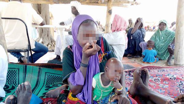 Une jeune femme faisant partie de Boko Haram à 50km de Bol - Sputnik France