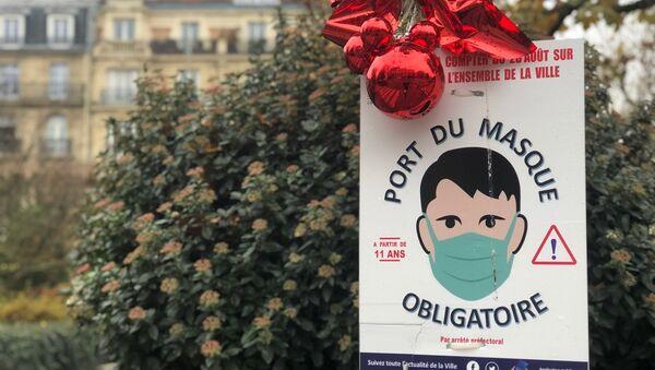 Port du masque obligatoire à Paris. Noël approche... - Sputnik France