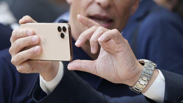 Un iPhone 11 Pro - Sputnik France