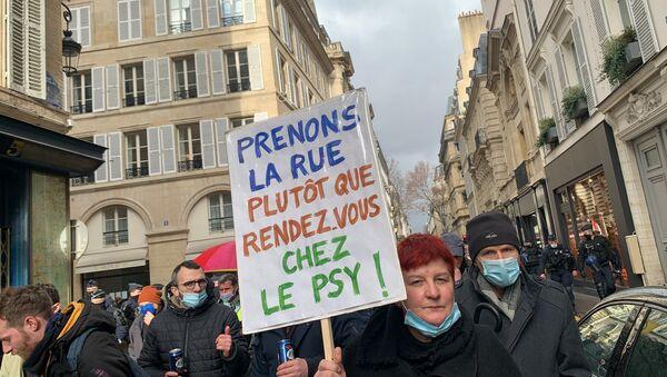 Des manifestants contre les licenciements se rassemblent ce samedi à Paris près de l'Assemblée nationale, 23 janvier 2021 - Sputnik France