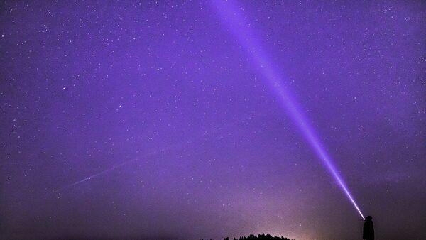 Lumière dans le ciel, image d'illustration - Sputnik France