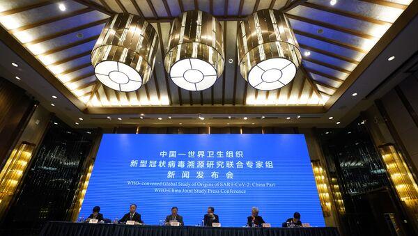 Une conférence de presse sur l'étude conjointe OMS-Chine se tient à la fin d'une mission visant à découvrir les origines de la pandémie - Sputnik France