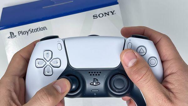 Manette sans fil Sony DualSense pour PS5 (archive photo) - Sputnik France