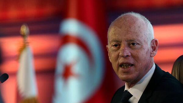 Le président tunisien Kais Saied donne une conférence sur le droit constitutionnel lors d'une visite d'État au Qatar, lors d'un événement organisé par l'université de Lusail, le 16 novembre 2020. - Sputnik France