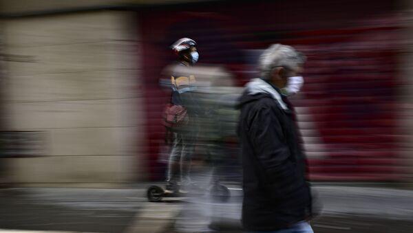 Un homme portant une masque en Espagne (image d'illustration) - Sputnik France