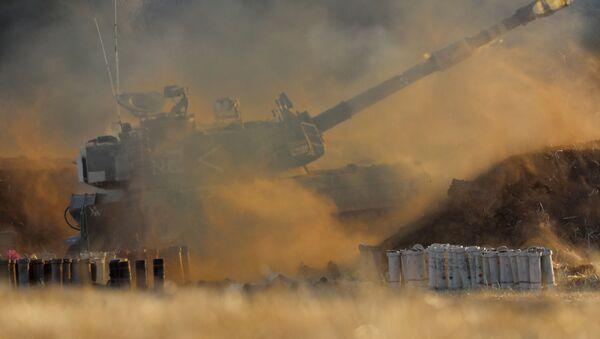 Une unité de l'armée israélienne tire en direction de la bande de Gaza, le 13 mai 2021 - Sputnik France