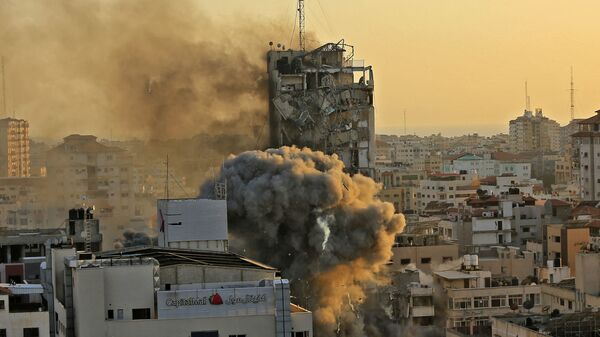 Une tour détruite dans une frappe israélienne contre Gaza, le 12 mai 2021  - Sputnik France