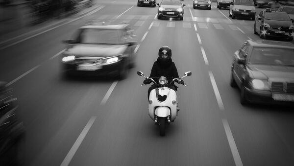Un scooter en ville. Image d'illustration - Sputnik France
