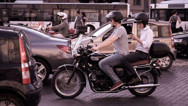 Une moto en ville. Image d'illustration - Sputnik France