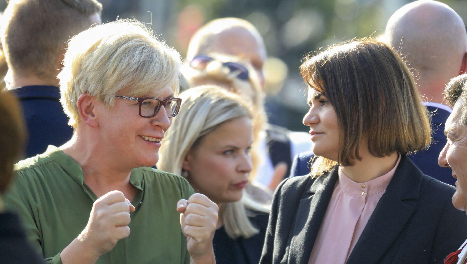 L'opposante biélorusse Svetlana Tikhanovskaya (à droite) et la Première ministre lituanienne Ingrida Simonyte (à gauche) lors d'une manifestation à Vilnius le 9 août 2021. - Sputnik France, 1920, 11.08.2021