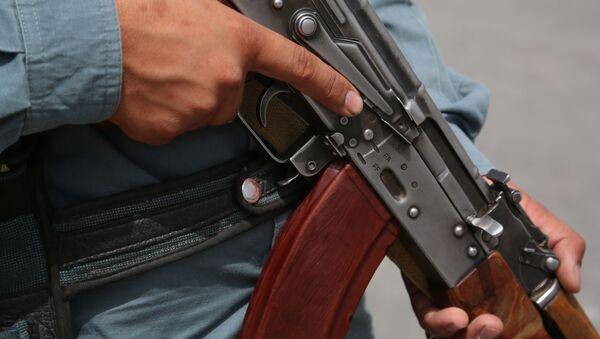 Une arme d'un policier afghane (image d'illustration) - Sputnik France