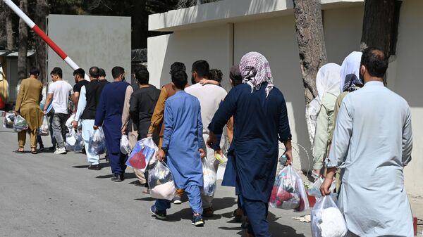 Des Afghans souhaitant quitter Kaboul, le 28 août 2021 - Sputnik France