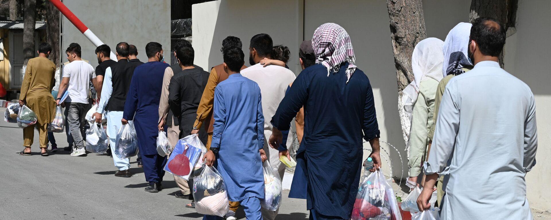 Des Afghans souhaitant quitter Kaboul, le 28 août 2021 - Sputnik France, 1920, 31.08.2021