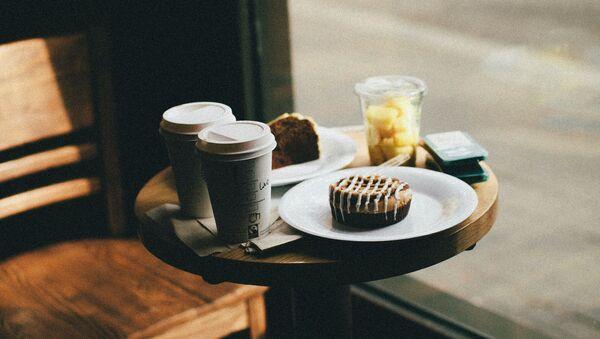 Dans un café, image d'illustration - Sputnik France