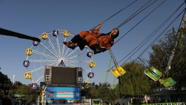 Une Afghane dans le parc d'attraction à Kaboule - Sputnik France