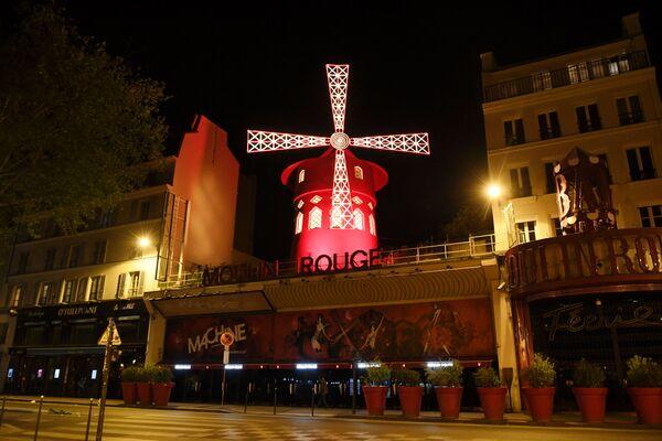 Le lieu n'est pas choisi au hasard: Montmartre est un lieu de fête et un quartier exempté de taxes sur l'alcool. Le cabaret doit son nom au moulin en bois aux ailes rouges créé par l'illustrateur Adolphe Léon Willette. - Sputnik France