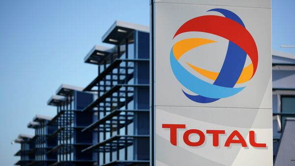 View of the logo of French oil giant Total in front of the oil refinery of Donges, near Nantes, in this December 20, 2013 file photo - Sputnik France