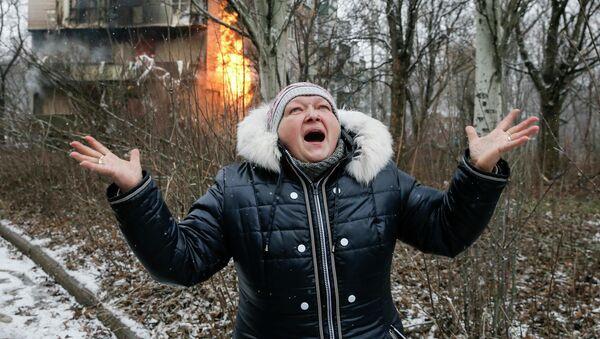 Una mujer en Donetsk - Sputnik France