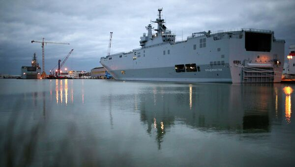 The two Mistral-class helicopter carriers Sevastopol (L) and Vladivostok are seen at the STX Les Chantiers de l'Atlantique shipyard site in Saint-Nazaire, western France, December 23, 2014. - Sputnik France