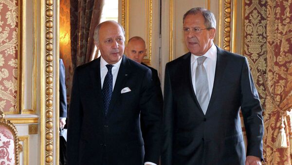 French Foreign Affairs Minister Laurent Fabius (L) walks with Russian Foreign Minister Sergey Lavrov prior to their meeting at the Quai d'Orsay ministry in Paris February 24, 2015. - Sputnik France