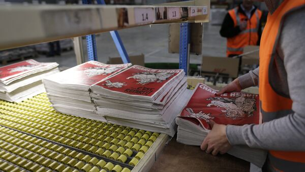 An employee checks the forthcoming edition of the weekly newspaper Charlie Hebdo, on February 24, 2015 in Villabe, south of Paris - Sputnik France