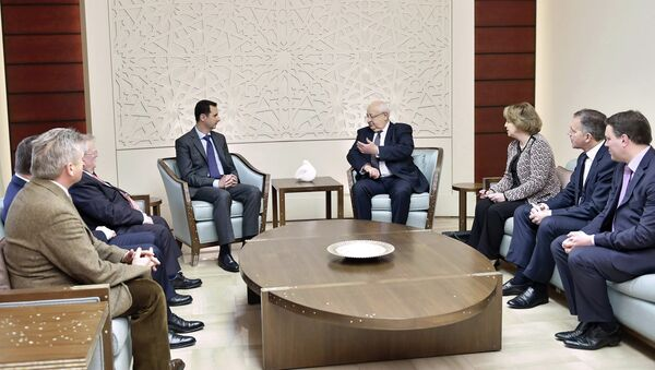 Syria's President Bashar al-Assad (center L) meets with a French delegation headed by Senate member, Head of the Senate�s French-Syrian Friendship Committee Jean-Pierre Vial,(center R) in Damascus February 25, 2015, - Sputnik France