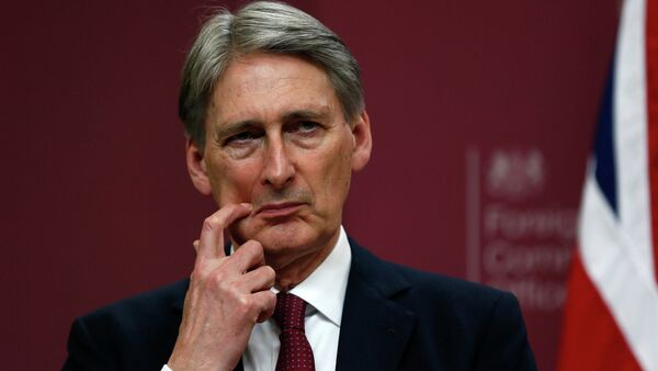 Britain's Foreign Secretary Philip Hammond gestures during a press conference at the Foreign and Commonwealth Office in London - Sputnik France