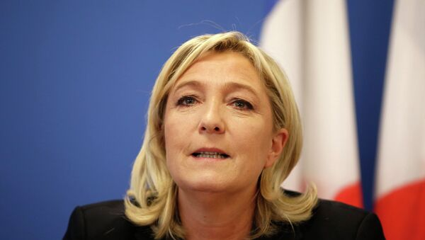 France's National Front political party head Marine Le Pen speaks during a news conference at the party headquarters in Nanterre near Paris February 6, 2015. REUTERS/Charles Platiau - Sputnik France