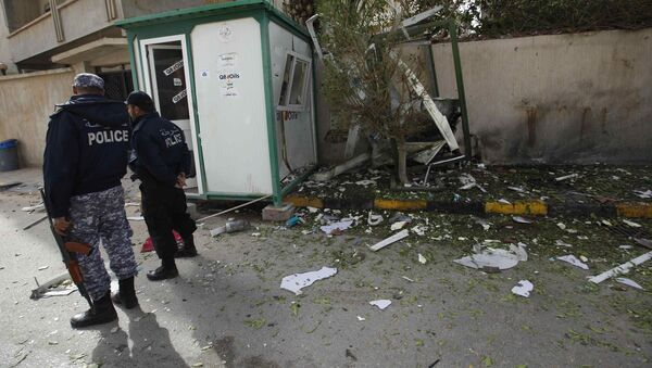 Security personnel stand near the site of a bomb blast at the gate of the Iranian ambassador's residence in Tripoli - Sputnik France