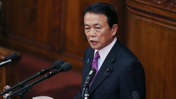Japan's Finance Minister Taro Aso speaks during a opening session at the lower house of Parliament in Tokyo, Monday, Jan. 26, 2015 - Sputnik France