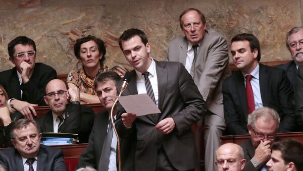 French MP of the Isere department, Olivier Vran (C), answers a question during the weekly session of questions to the government at the National Assembly on October 24, 2012 in Paris. - Sputnik France