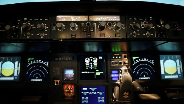 A picture inside a flight simulator shows the the cockpit of an Airbus A320 in Vienna on March 26, 2015. - Sputnik France