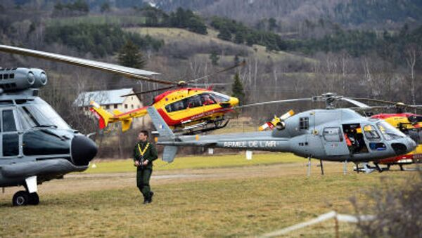 Helicopters of the French Air Force (back) and civil security services are seen in Seyne, south-eastern France, on March 24, 2015, near the site where a Germanwings Airbus A320 crashed in the French Alps. - Sputnik France