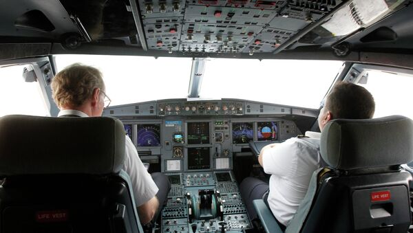 Pilots sit at the cockpit of a VietJet A320 airplane before departure for Bangkok in this September 25, 2013 file photo. - Sputnik France