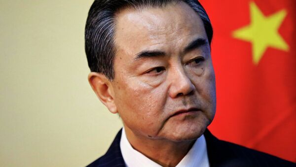 China's Foreign Minister Wang Yi listens during a meeting with Sudan's Foreign Minister Ali Karti in Khartoum January 11, 2015 - Sputnik France