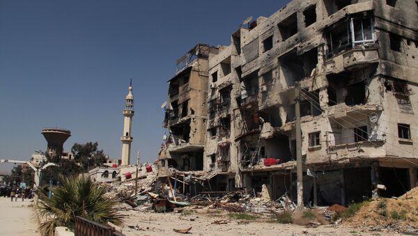 Разрушенный дом в лагере палестинских беженцев Ярмук на окраине Дамаска - Sputnik France