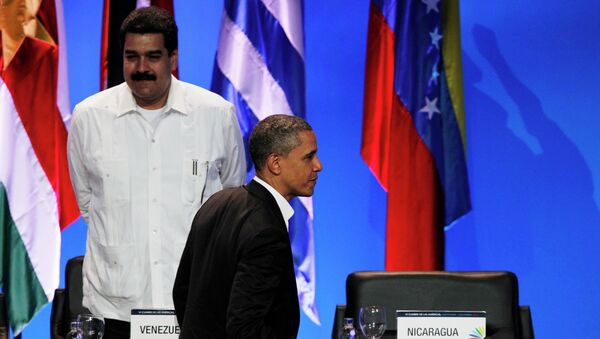 President Barack Obama walks past the empty seat of Nicaragua as he leaves the opening ceremony of the sixth Summit of the Americas after shaking hands with Venezuela's Prime Minister Nicolas Maduro, left, in Cartagena, Colombia, Saturday April 14, 2012 - Sputnik France