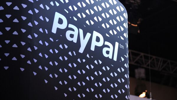 The logo of online payment company PayPal is pictured during LeWeb 2013 event in Saint-Denis near Paris on December 10, 2013 - Sputnik France