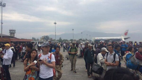 People stand on the runway outside the International Terminal after a earthquake hit, at Tribhuvan International Airport, Kathmandu, Nepal, April 25, 2015 - Sputnik France