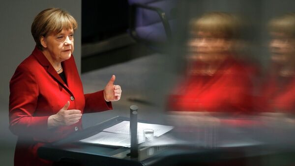 German Chancellor Angela Merkel is refelcted in a glass barrier as she gives a speech during a debate at the Bundestag, the lower house of parliament, in Berlin March 19, 2015. - Sputnik France