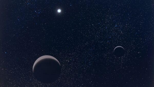 Pluton et son plus grand satellite Charon - Sputnik France