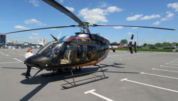 Вертолет Bell 407 GX прибывает для участия в выставке вертолетной индустрии HeliRussia 2015 в Москве - Sputnik France